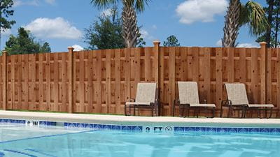 Pool and privacy fence made with ProWood Dura Color treated fencing