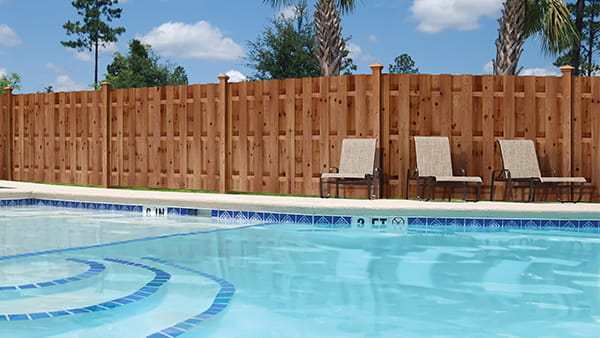 pool with privacy fence made with ProWood Dura Color pressure treated fencing