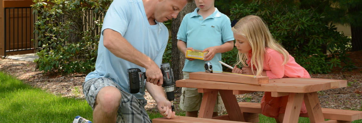 Dad building a child-size picnic table with ProWood pressure-treated lumber